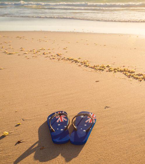 Thongs on beach shutterstock_661892545