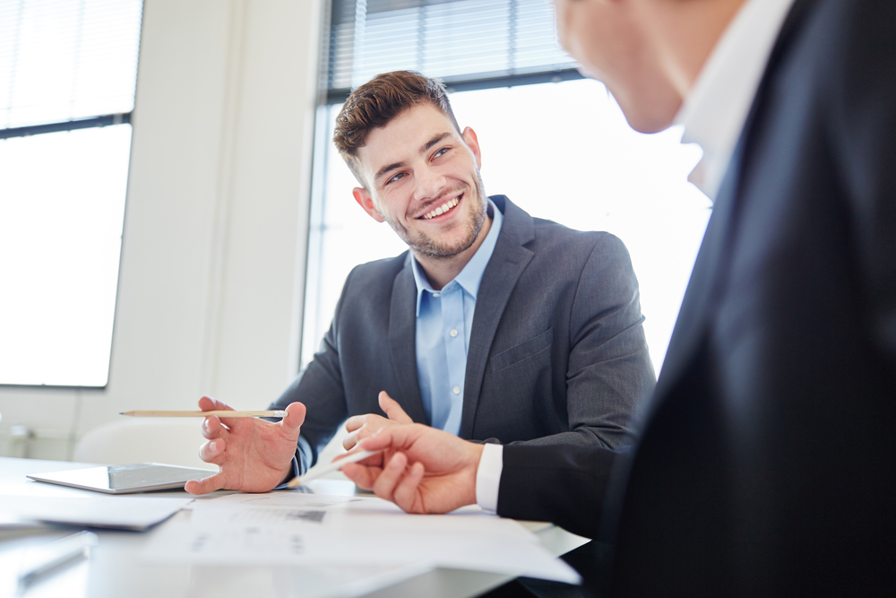 Two guys in meeting shutterstock_585006853